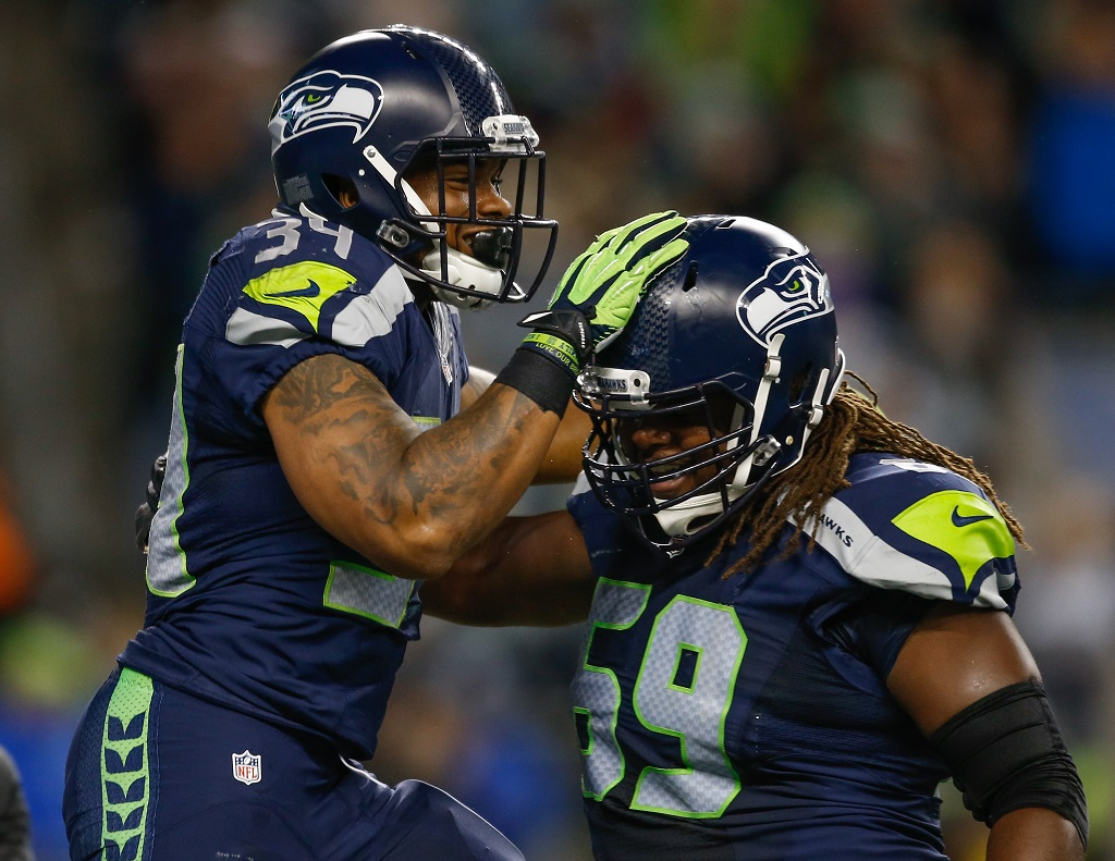 SEATTLE, WA - SEPTEMBER 03:  Running back Thomas Rawls #34 (L) of the Seattle Seahawks is congratulated by tackle Terry Poole #69 after scoring a touchdown against the Oakland Raiders at CenturyLink Field on September 3, 2015 in Seattle, Washington.
