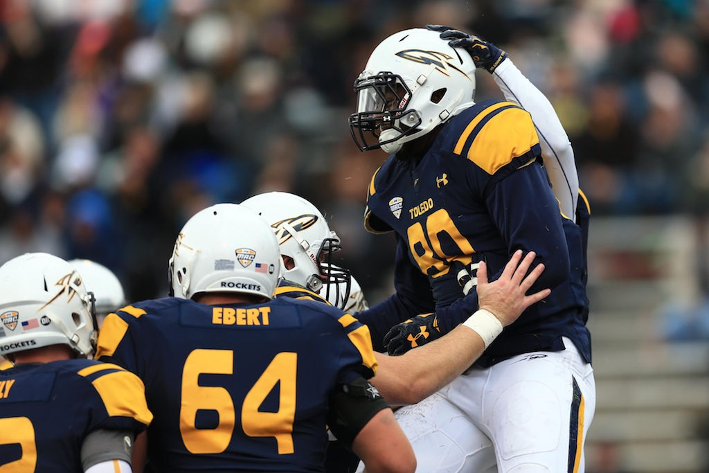 Toledo players celebrate a touchdown
