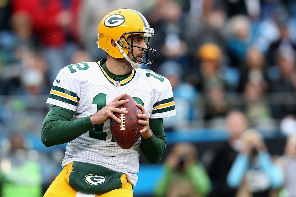 Aaron Rodgers drops back to pass against the Panthers