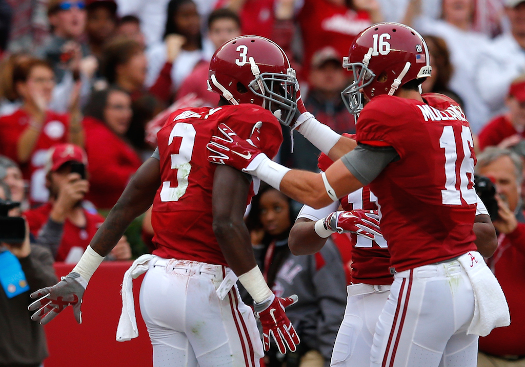 Alabama players celebrate a touchdown