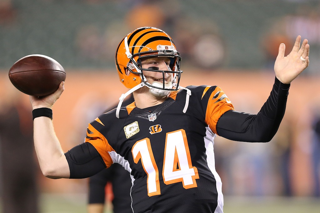Andy Dalton warms up for a game against the Browns