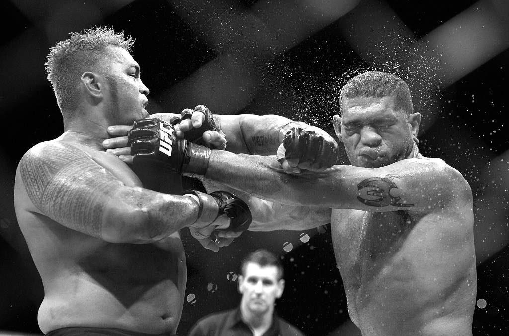 BRISBANE, AUSTRALIA - DECEMBER 07: (This digital image has been converted to black & white) Mark Hunt connects with a punch during the UFC Brisbane bout between Mark Hunt and Antonio 'Big Foot' Silva of Brazil at the Brisbane Entertainment Centre on December 7, 2013 in Brisbane, Australia.