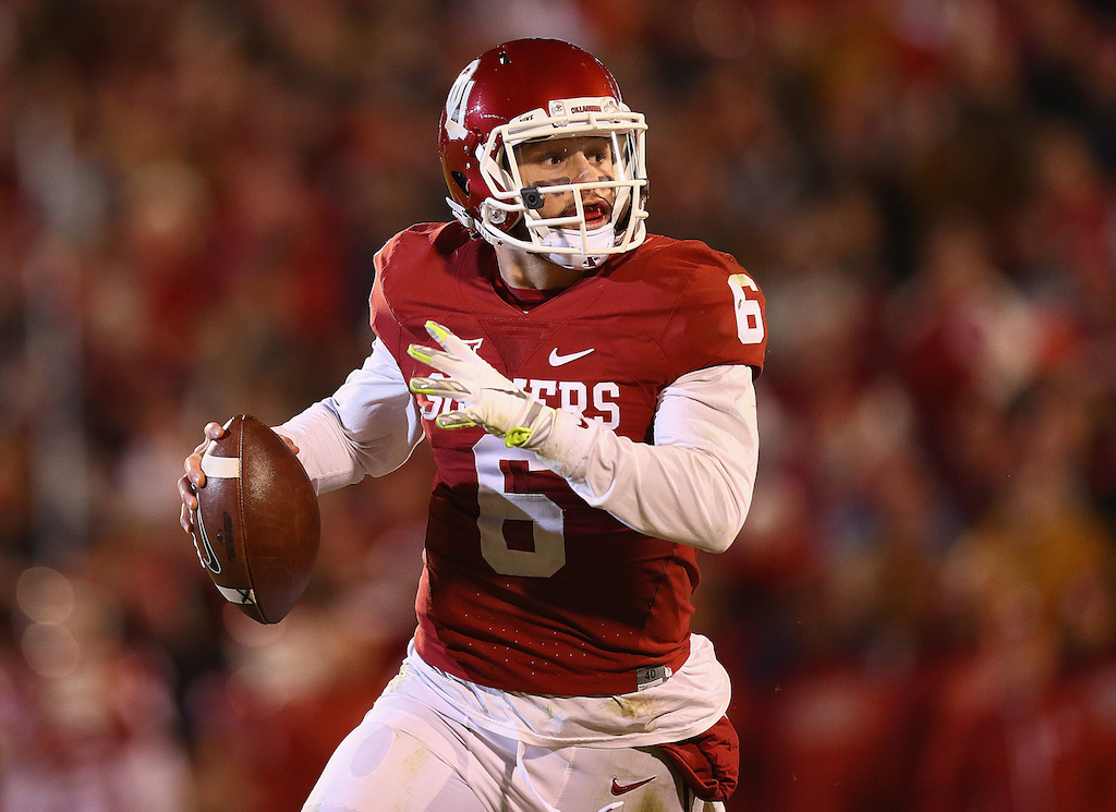 Baker Mayfield looks to throw against TCU