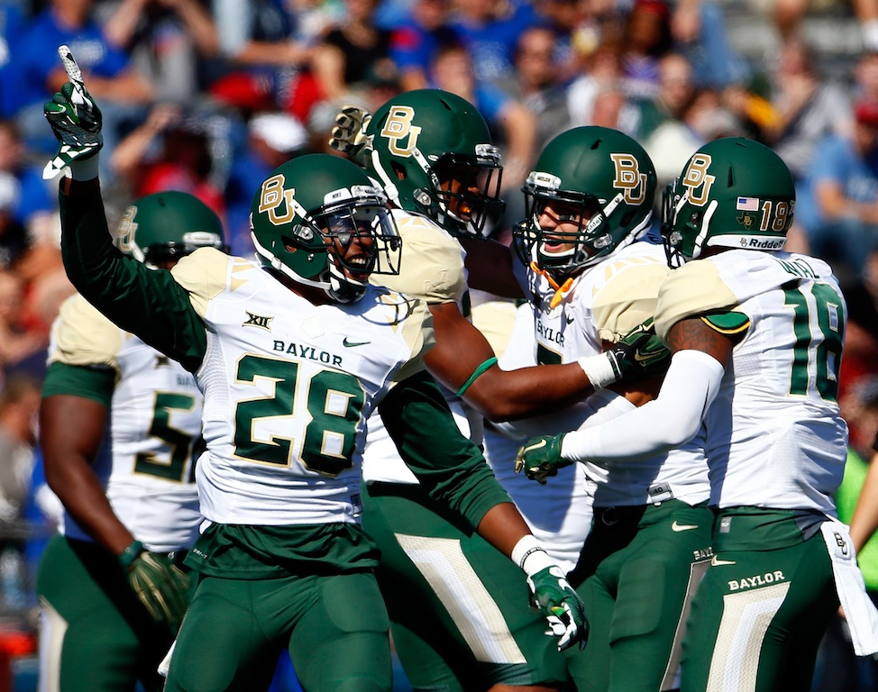 LAWRENCE, KS - OCTOBER 10: Safety Orion Stewart #28 of the Baylor Bears celebrates after a fumble recovery during the game against the Kansas Jayhawks at Memorial Stadium on October 10, 2015 in Lawrence, Kansas. (Photo by Jamie Squire/Getty Images)