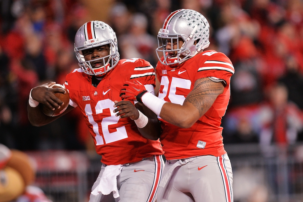 Cardale Jones #12 celebrates with teammate