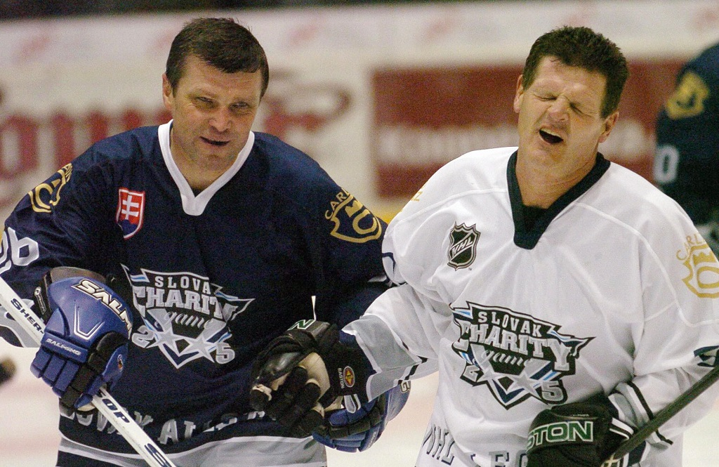 Bratislava, SLOVAKIA: Chris Nilan (R) of NHL Legends all star team ices with Peter Stastny (L) of Slovakia all star team during a benefit exhibition match in Bratislava, Slovakia, 10 December 2005. Stastny, brother of NHL Legend Peter Stastny, was playing for the Quebec Nordiques.