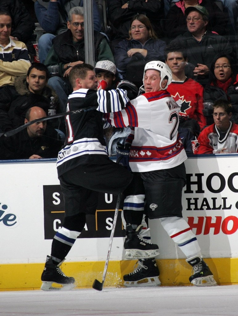 Two hockey players fighting