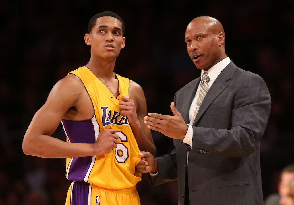 Lakers guard Jordan Clarks speaks with head coach Byron Scott