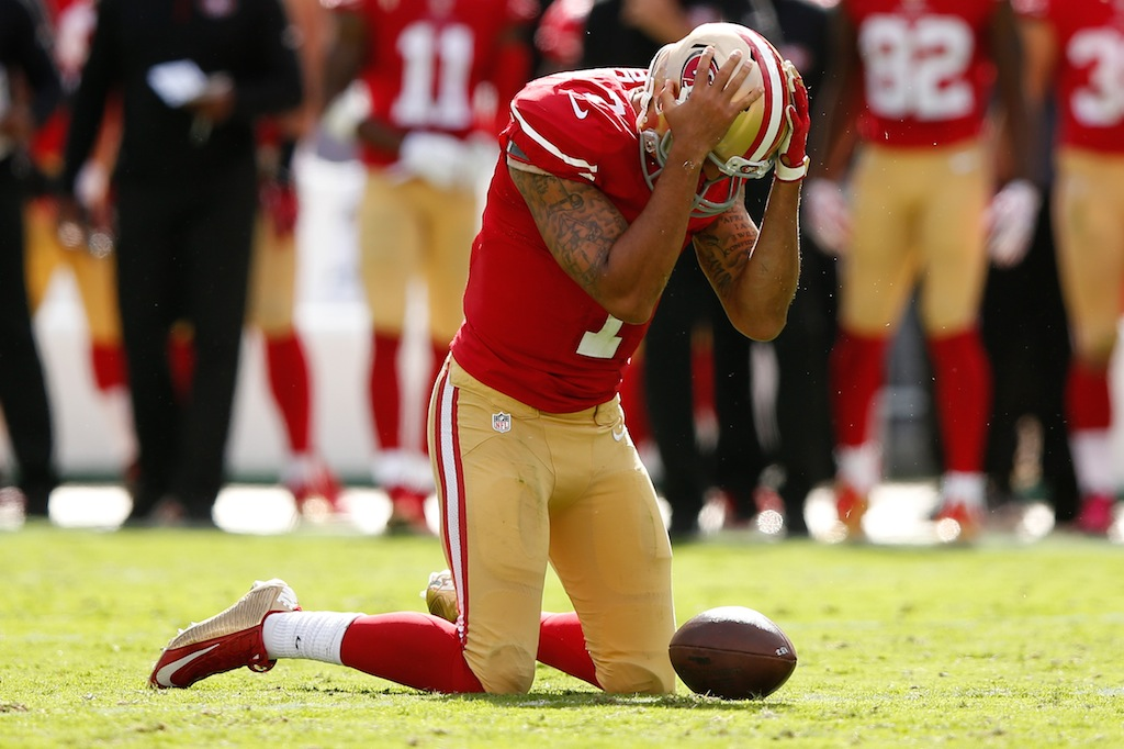Colin Kaepernick reacts after being tackled against the Ravens