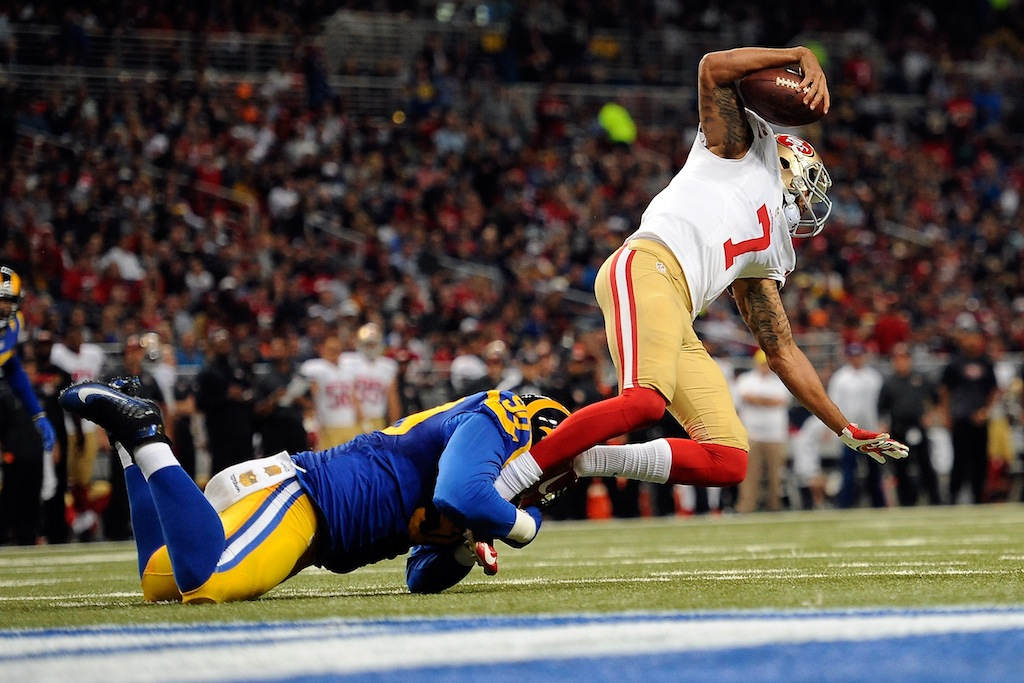 Colin Kaepernick #7 is sacked by the Rams