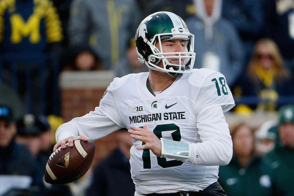 Connor Cook looks to pass