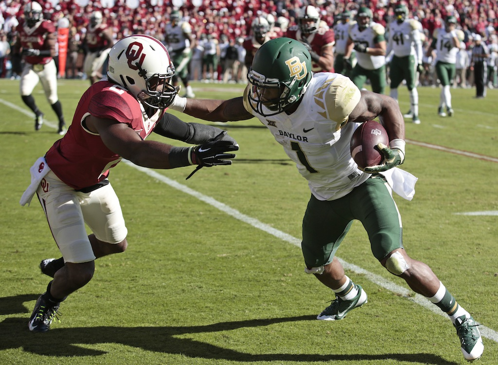 Corey Coleman #1 tries to get by a Sooner defender