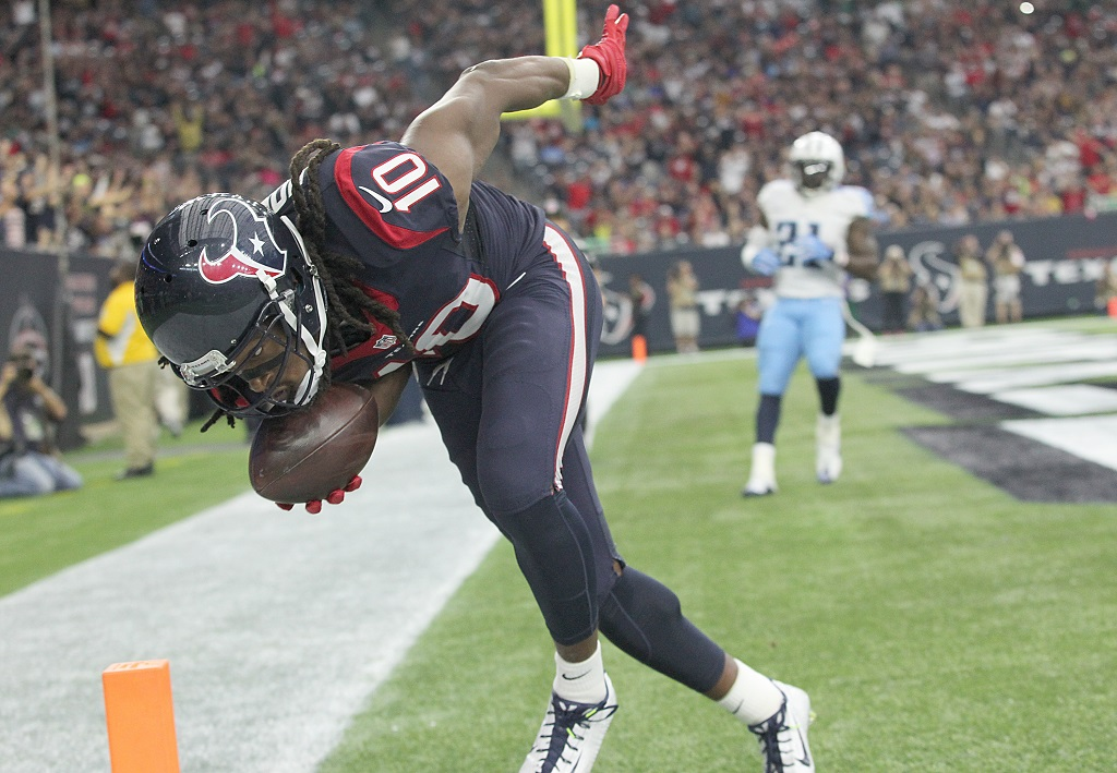 HOUSTON, TX - NOVEMBER 01: DeAndre Hopkins #10 of the Houston Texans makes a touchdown catch against Jason McCourty #30 of the Tennessee Titans in the second quarter on November 1, 2015 at NRG Stadium in Houston, Texas.