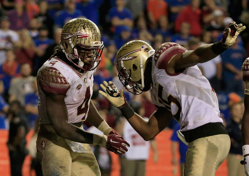 Dalvin Cook #4 and Travis Rudolph #15 of the Florida State celebrate a touchdown