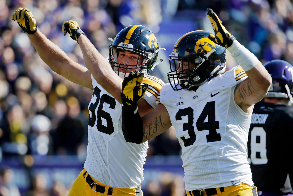 Iowa Hawkeyes celebrate blocking a pass