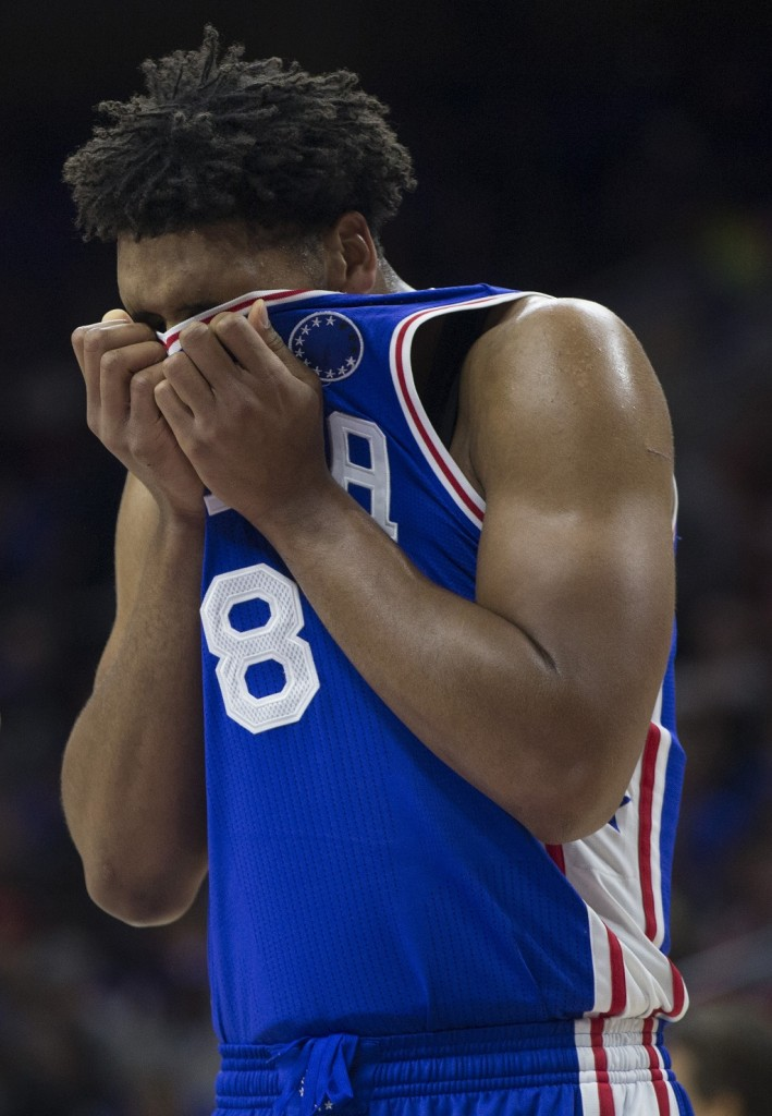 Jahlil Okafor #8 of the Philadelphia 76ers wipes the sweat from his face during the game against the Utah Jazz on October 30, 2015 at the Wells Fargo Center in Philadelphia, Pennsylvania.