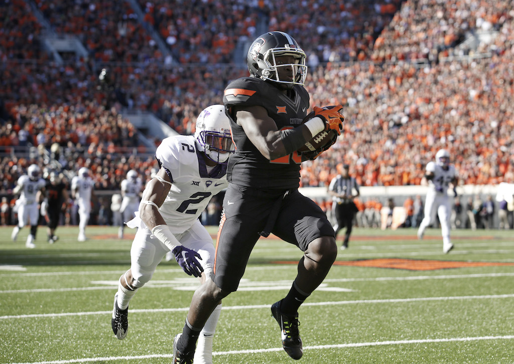 James Washington #28 of the Oklahoma State Cowboys runs a reception in for a touchdown