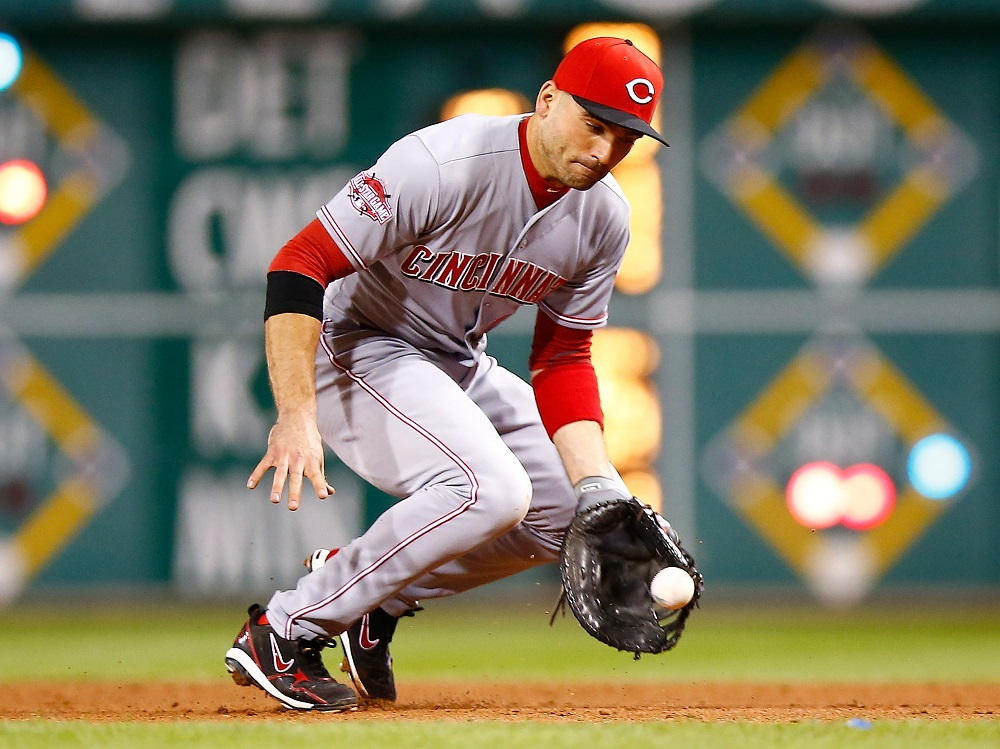 Joey Votto scoops up a ground ball.