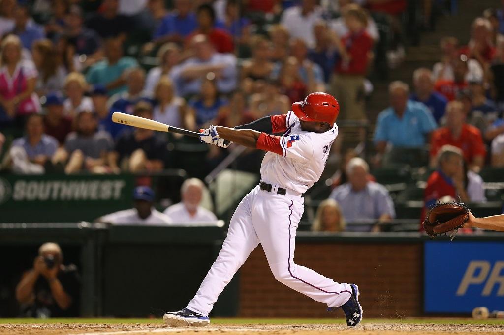 ARLINGTON, TX - SEPTEMBER 26:  Jurickson Profar #13 of the Texas Rangers hits a walkoff homerun against the Los Angeles Angels at Rangers Ballpark in Arlington on September 26, 2013 in Arlington, Texas.