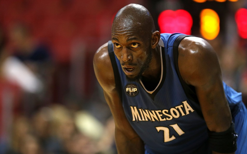 A sweaty Kevin Garnett rests during a game.