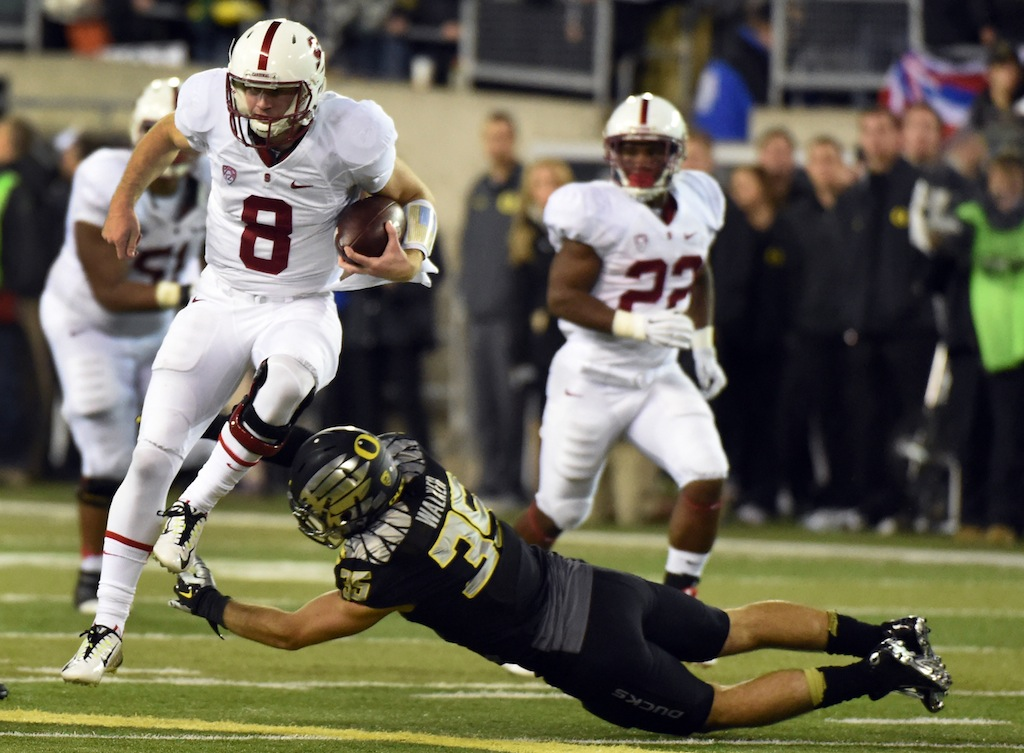 Kevin Hogan #8 runs against Oregon