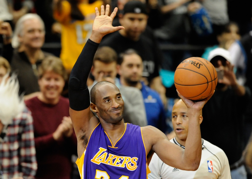 Kobe Bryant waves to the crowd