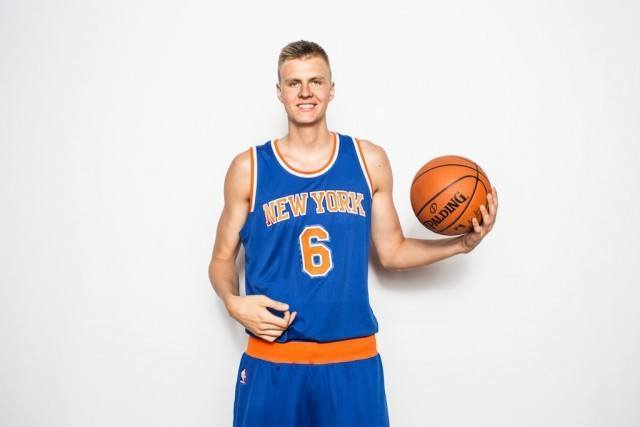 The New York Knicks' Kristaps Porzingis smiles for the camera