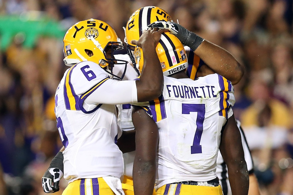 Brandon Harris #6 celebrates with Leonard Fournette #7 of the LSU Tigers after scoring a touchdown