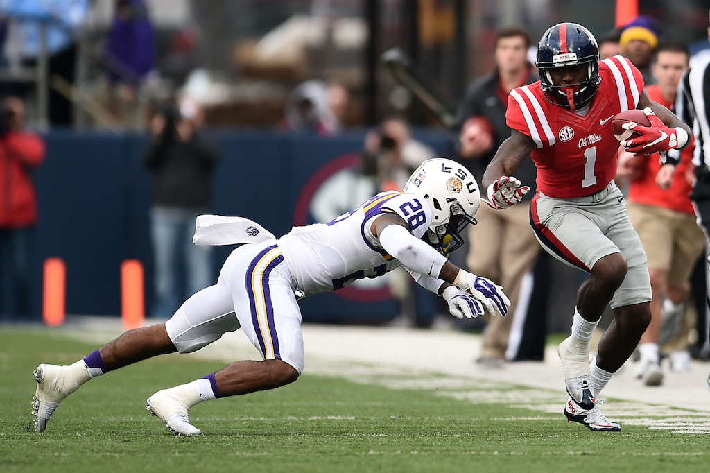 Laquon Treadwell #1 of the Mississippi Rebels is pursued by Jalen Mills #28 of the LSU Tigers