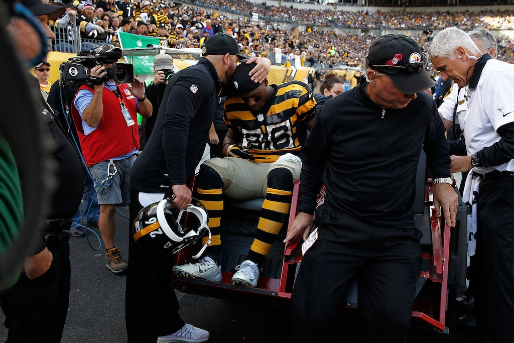 Le'Veon Bell is carted off the field after an injury