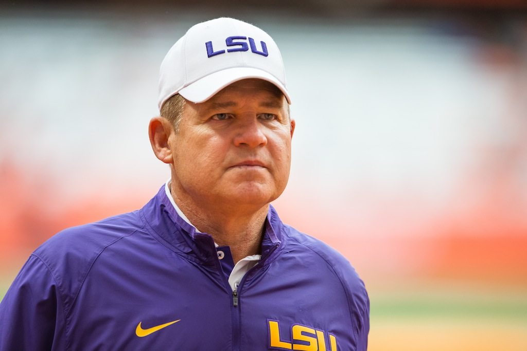 Les Miles looks on during warm ups