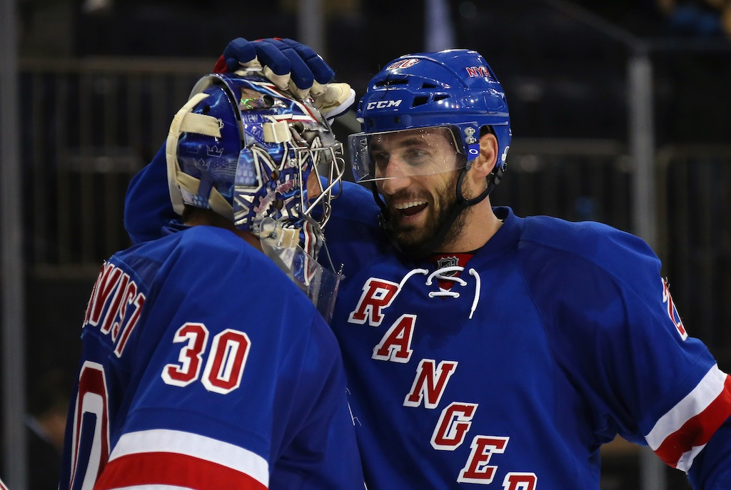Henrik Lundqvist #30 and Dominic Moore #28 of the New York Rangers celebrate their win