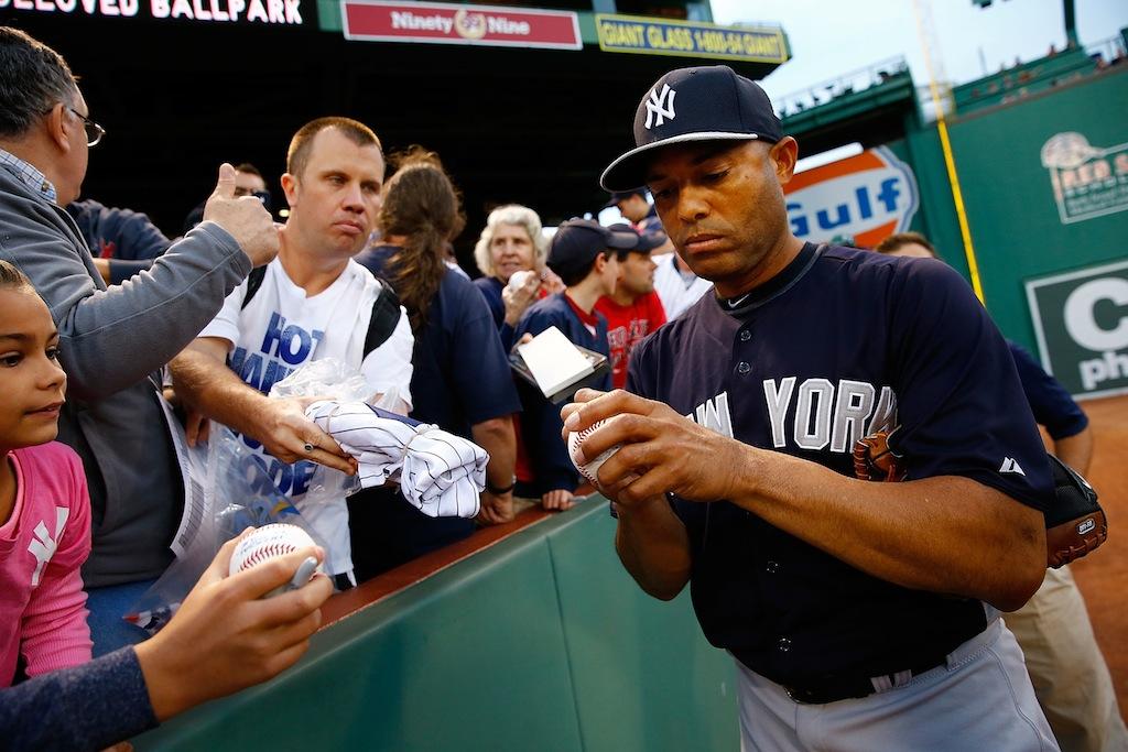 Mariano Rivera signs a baseball