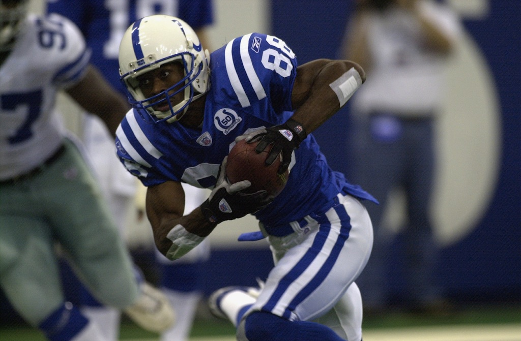 Marvin Harrison catches the ball against the Cowboys
