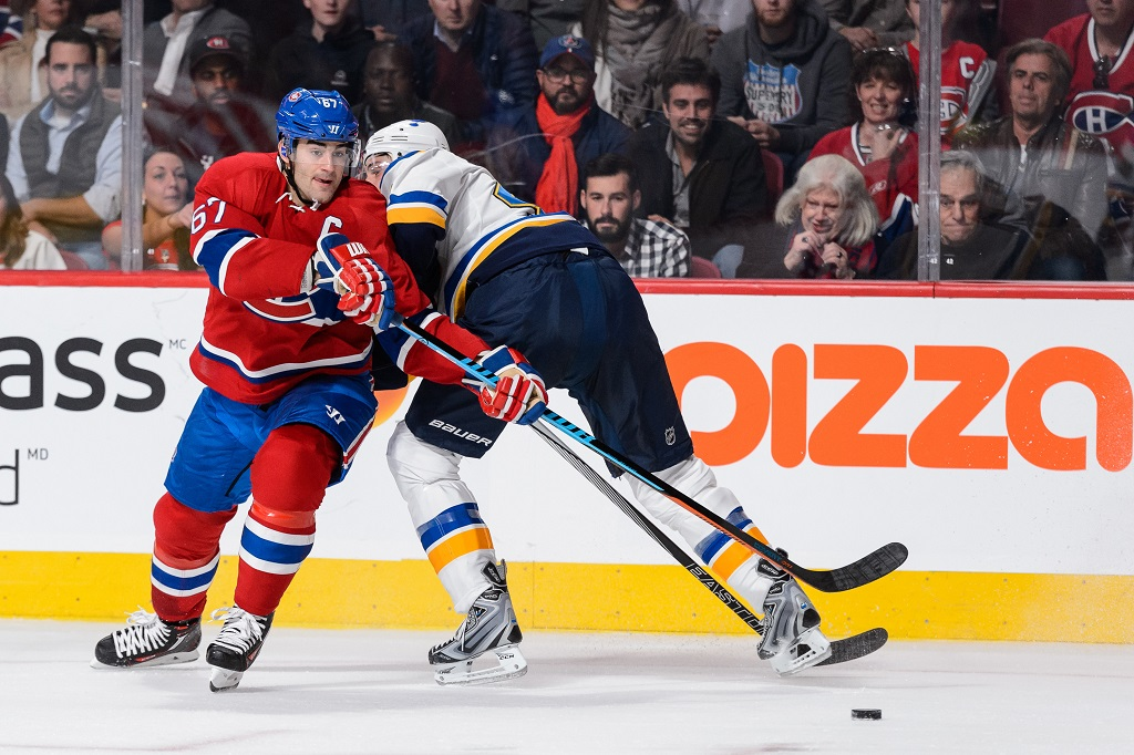 MONTREAL, QC - OCTOBER 20:  Max Pacioretty #67 of the Montreal Canadiens sidesteps Robert Bortuzzo #41 of the St. Louis Blues during the NHL game at the Bell Centre on October 20, 2015 in Montreal, Quebec, Canada.