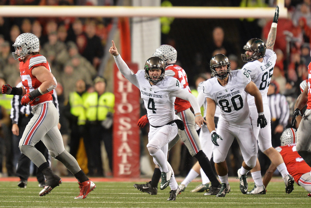 Michael Geiger #4 of the Michigan State Spartans celebrates after kicking a 41-yard field goal as time expired