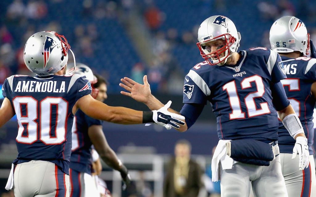 Danny Amendola #80 high fives Tom Brady