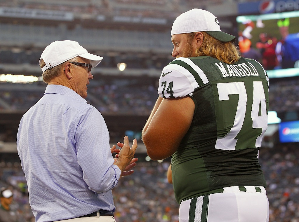 Nick Mangold #74 talks to Jets owner Woody Johnson