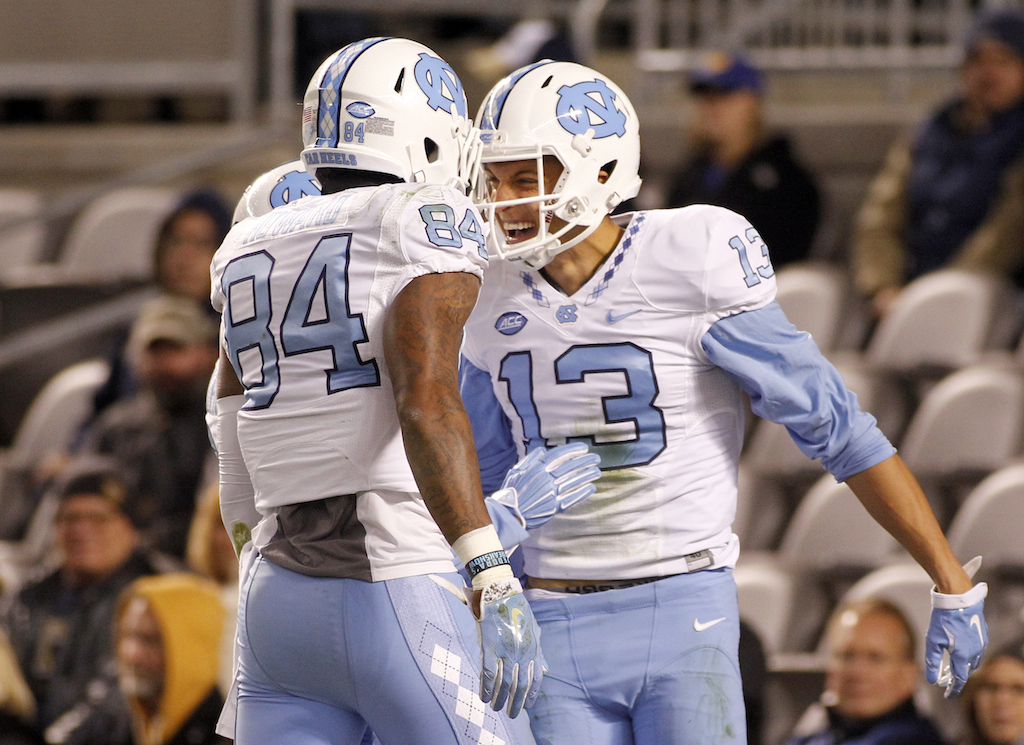 Mack Hollins #13 of the North Carolina Tar Heels celebrates with Bug Howard #84 after catching a 32 yard touchdown pass