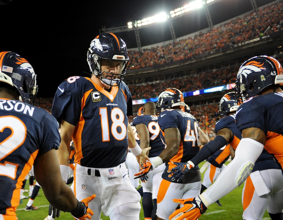 Peyton Manning #18 and the Denver Broncos