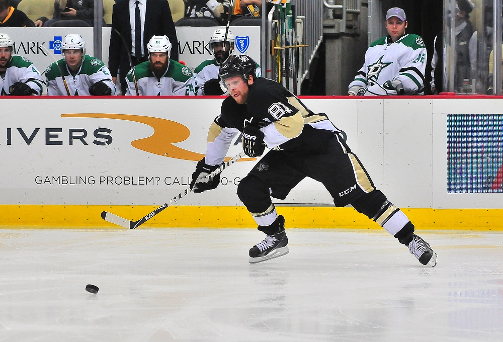 Phil Kessel of the Pittsburgh Penguins skates with the puck against the Dallas Stars.