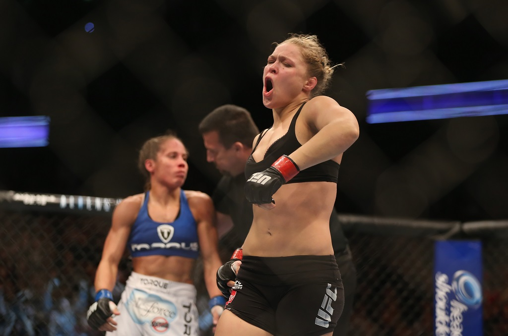 ANAHEIM, CA - FEBRUARY 23:  Ronda Rousey celebrates her UFC Bantamweight Title over Liz Carmouche at Honda Center on February 23, 2013 in Anaheim, California.