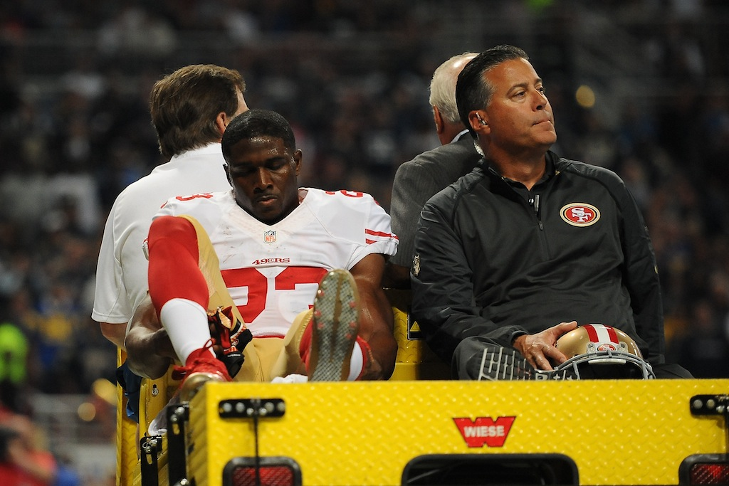 Reggie Bush is carted off the field after injuring his knee