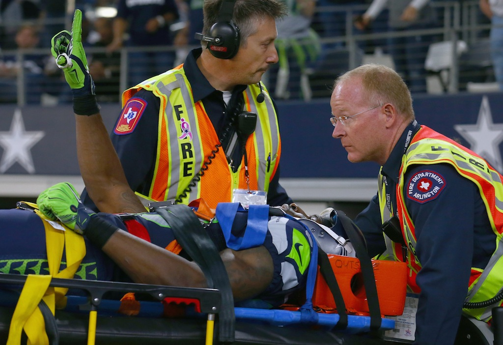 Ricardo Lockette waves a finger while being carted off the field