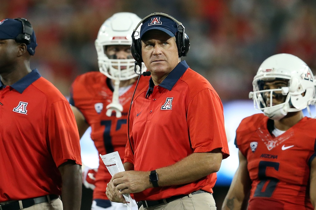 Arizona head coach Rich Rodriguez looks at an instant replay