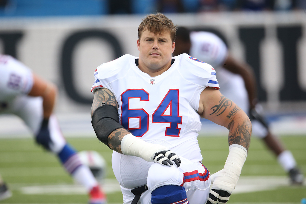 Richie Incognito takes a knee on the field