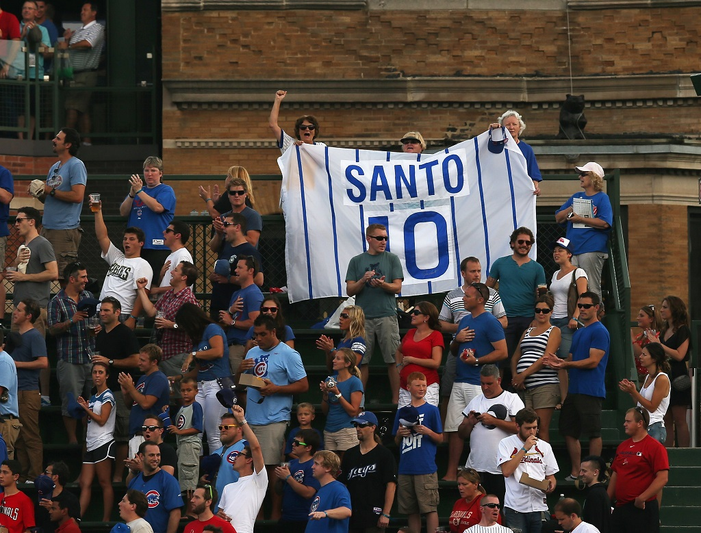 CHICAGO, IL - JULY 27:  Fans in the right field bleachers hold a sign honoring former Chicago Cub the late Ron Santo, before the Cubs take on the St. Louis Cardinals at Wrigley Field on July 27, 2012 in Chicago, Illinois. Santo was induced into the Hall of Fame last weekend.