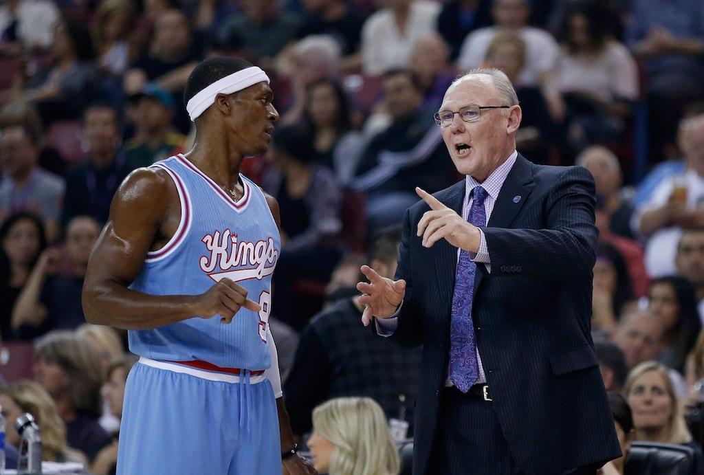 Kings point guard Rajon Rondo speaks with head coach George Karl