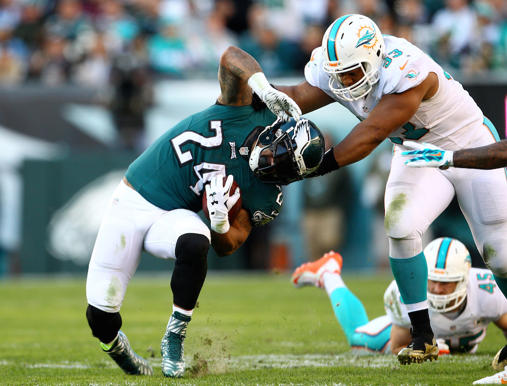 Ryan Mathews #24 is tackled by Ndamukong Suh
