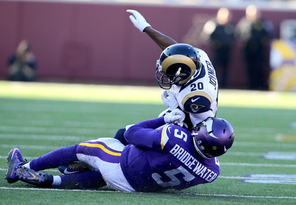 Teddy Bridgewater #5 is elbowed as he tries to slide
